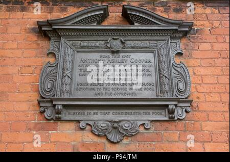 A black, decorative plaque on Harrow-On-The-Hill for Anthony Ashley Cooper, the 7th Earl of Shaftesbury, who attended Harrow School as a boy - Stock Photo