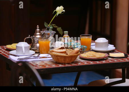 Delicious breakfast in Moroccan style served in riad (traditional Moroccan hotel) - Stock Photo