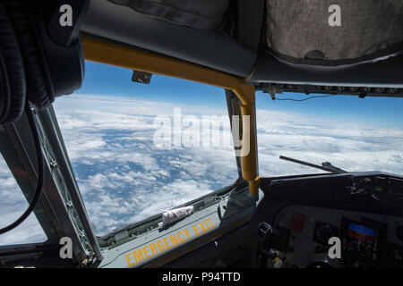 A view out of the cockpit window of a KC-135 Stratotanker with the 121st Air Refueling Wing, Ohio June 27, 2018.  The Stratotanker was flying back to Rickenbacker Air National Guard Base, Ohio from northeastern United States.  (U.S. Air National Guard photo by Airman 1st Class Tiffany A. Emery) - Stock Photo