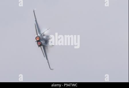A pilot from the Swiss Air Force demonstrates the flight capabilities of a F/A-18C Hornet during the 2018 Royal International Air Tattoo at RAF Fairford, United Kingdom on July 13, 2018. This year's RIAT celebrated the 100th anniversary of the RAF and highlighted the United States' ever-strong alliance with the UK. (U.S. Air Force photo by TSgt Brian Kimball) - Stock Photo