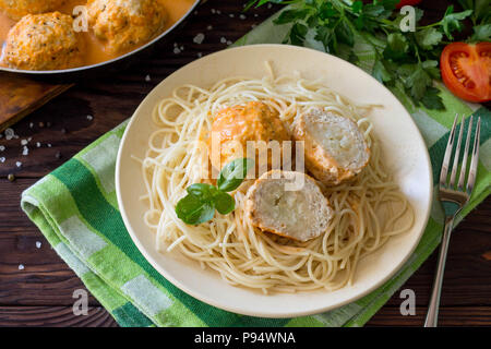 Thanksgiving Turkey dinner. Meat balls turkey with cauliflower in tomato sauce on a wooden table. - Stock Photo