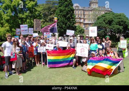 A Donald Trump protest in Bournemouth on the 14th of July 2018 coincided with his visit to the UK. The protest in Bournemouth Gardens was organised by Global Justice UK. Credit: Haydn Wheeler/Alamy Live News - Stock Photo