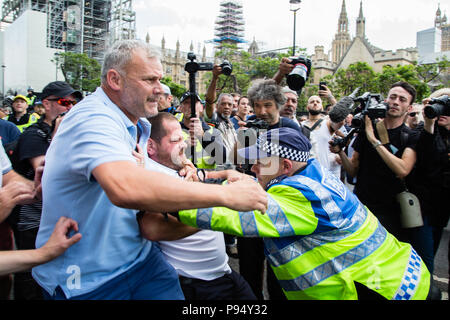 London UK 14th July 2018 'Free Tommy' (Robinson) and Trump supporter confronts a police man in central London. - Stock Photo