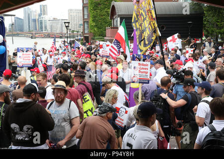 London, England. 14th July 2018. Despite police attempts to prevent the pro-Trump protest due to fears of violence from far-left counter protesters, supporters of Donald Trump assembled at midday outside the US Embassy in Vauxhall, London to welcome him on his visit to the UK. Credit: Richard Milnes/Alamy Live News - Stock Photo