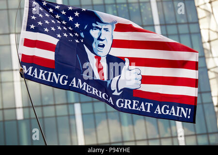 London, U.K. - 14 July 2018: A 'Making America Great Again' flies in front of the Embassy of the United States of America in London during a Pro-Donald Trump rally there. - Stock Photo