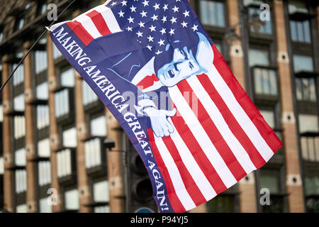 London, U.K. - 14 July 2018: A 'Making America Great Again' flies in front of Portcullis House, Westminster during a Pro-Donald Trump rally and march. - Stock Photo