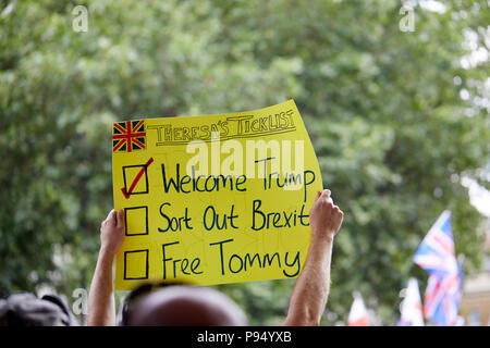London, U.K. - 14 July 2018: A banner - saying Theresa's Ticklist - held aloft at a Tommy Robinson rally in Whitehall. - Stock Photo