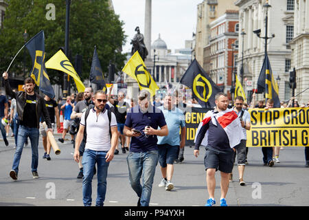 London, U.K. - 14 July 2018: Members of Generation Identity march down Whitehall at a Tommy Robinson rally. - Stock Photo