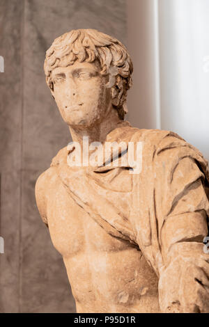 Youth of Mantineia, Pelonponnesian Marble, Classical Period, Hellenistic Style, Possibly a young Antinous favorite of Emperor Hardian, 130 to 140 AD. - Stock Photo