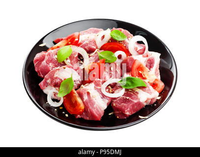 Uncooked shish kebab on plate. Raw pork barbecue isolated on white background - Stock Photo