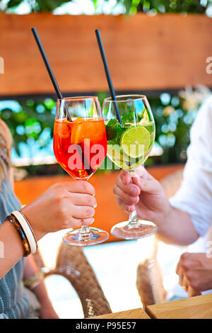 Cocktail glasses in the peoples hands. Cocktail party - Stock Photo