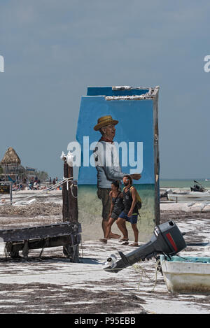 tourists in front of a ruin at tropical beach of Holbox island, Quintana Roo, Mexico. - Stock Photo