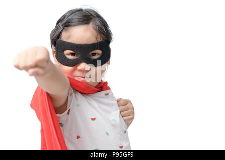Little child plays superhero isolated on white background, Girl power concept. - Stock Photo