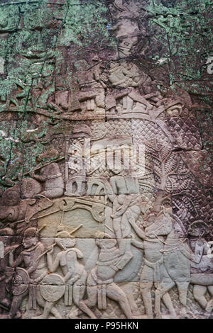 Cham warriors defeating the Khmer on the north wall of the Bayon Temple (Prasat Bayon) is richly decorated Khmer temple within the Angkor Thom area in - Stock Photo