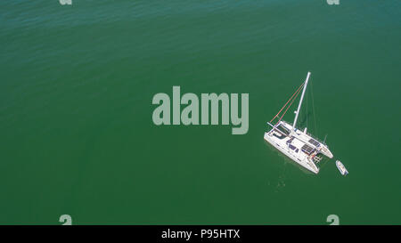 solitary sail boat as seen from above by a drone in Sag Harbor, NY - Stock Photo