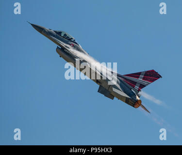 Royal Danish Air Force F-16 displaying in the blue sky above RNAS Yeovilton, UK during the International Air Day on 7/7/18. - Stock Photo