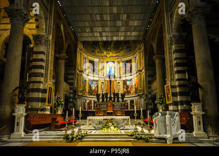 The interior altar featuring renaissance religious artwork inside the Pisa Duomo Cathedral in the Tuscan city of Pisa, Italy. - Stock Photo