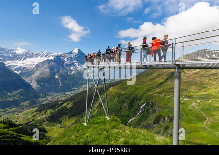 Viewing platform at Grindelwald-First, Jungfrau region of the Bernese Oberland Alps, Switzerland with views of the Eiger, Monsch and Jungfrau mountain - Stock Photo