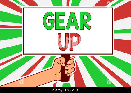Text sign showing Gear Up. Conceptual photo Asking someone to put his clothes or suit on Getting ready fast Man hand holding poster important protest  - Stock Photo