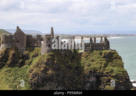 Dunluce Castle is a now-ruined medieval castle in Northern Ireland. It is located on the edge of a basalt outcropping in County Antrim. - Stock Photo