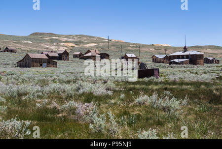 A view of the abandoned historic town of Bodie, California nestled on a hill. The town is now a State Park. - Stock Photo