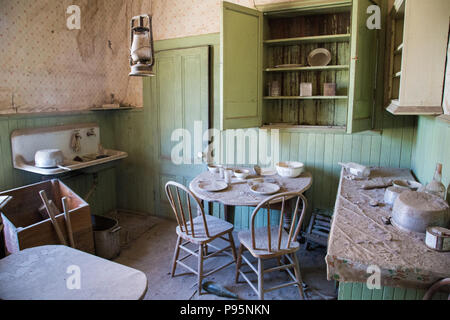 A kitchen in an abandoned home in Bodie, California, the best preserved ghost town in the USA. - Stock Photo