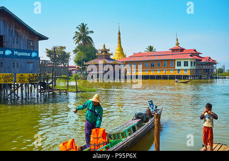 YWAMA, MYANMAR - FEBRUARY 18, 2018: The old Buddhist Temple houses in stilt buildings on Inle Lake, on February 18 in Ywama. - Stock Photo