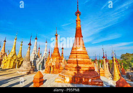 The Nyaung Ohak Buddhist site with numerous restored pagodas, located on the slope of the hill, Inn Thein, Inle Lake, Myanmar. - Stock Photo