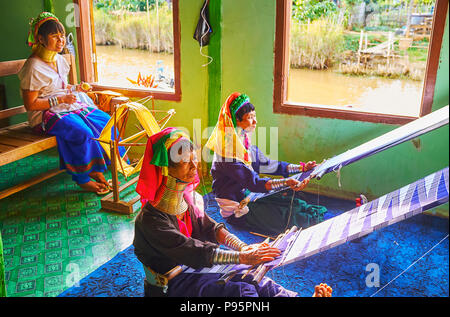 INLE LAKE, MYANMAR - FEBRUARY 18, 2018:  The women of Padaung Kayan people are well known for wearing brass neck rings, the travelers can meet them in