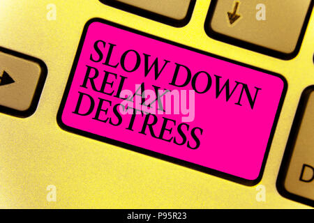 Writing note showing Slow Down Relax Destress. Business photo showcasing calming bring happiness and put you in good mood Keyboard pink key Intention  - Stock Photo