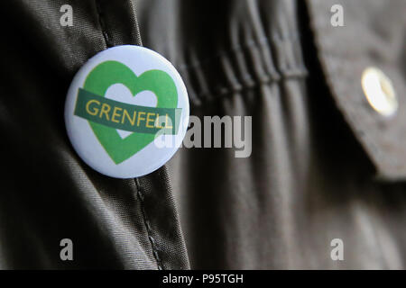 A person wearing Grenfell badge to mark Grenfell Tower fire one year anniversary.  The Grenfell Tower fire broke out on 14 June 2017 in the 24-storey Grenfell Tower block of public housing flats in North Kensington, West London, in which 72 people lost their lives.  Featuring: Atmosphere, View Where: London, United Kingdom When: 14 Jun 2018 Credit: Dinendra Haria/WENN - Stock Photo
