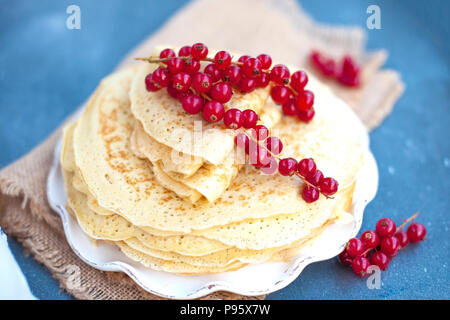 Thin sweet pancakes. traditional Russian food in the spring. Festive treat. Homemade breakfast. Free space for text or a postcard. - Stock Photo