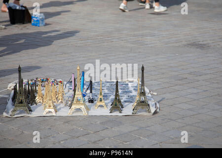 Eiffel Tower Souvenirs on Square outside Louvre in Paris, France - Stock Photo