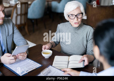 Female leader gives orders - Stock Photo
