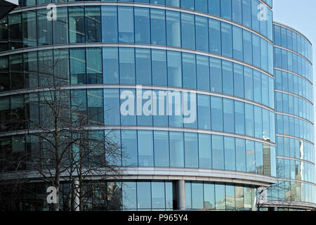 Office buildings covered in windows at London Bridge City on the south bank of the River Thames in London, England. - Stock Photo