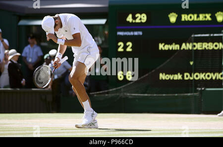 Novak Djokovic celebrates winning the Gentlemen's Singles Final on day thirteen of the Wimbledon Championships at the All England Lawn Tennis and Croquet Club, Wimbledon. PRESS ASSOCIATION Photo. Picture date: Sunday July 15, 2018. See PA story TENNIS Wimbledon. Photo credit should read: John Walton/PA Wire. RESTRICTIONS: Editorial use only. No commercial use without prior written consent of the AELTC. Still image use only - no moving images to emulate broadcast. No superimposing or removal of sponsor/ad logos. Call +44 (0)1158 447447 for further information. - Stock Photo