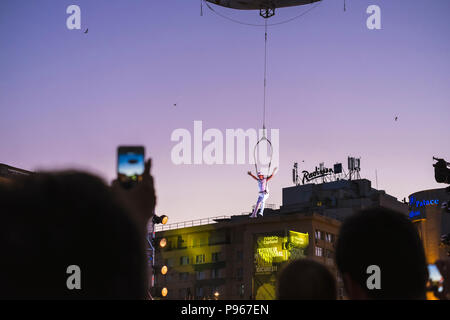 Bucharest, ROMANIA - July 14 2018: Beginning of the Sonics in Wish performance at Street Theater Festival. Aerial acrobatics performed on overturned s - Stock Photo