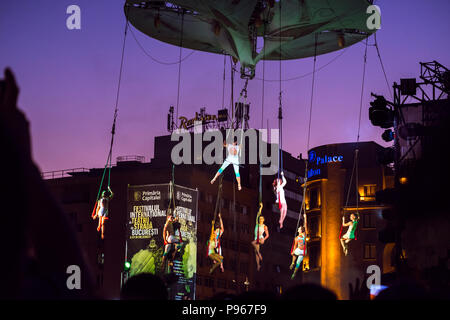 Bucharest, ROMANIA - July 14 2018: Sonics in Wish performance at Street Theater Festival. Aerial acrobatics performed on overturned stage, hanging hig - Stock Photo