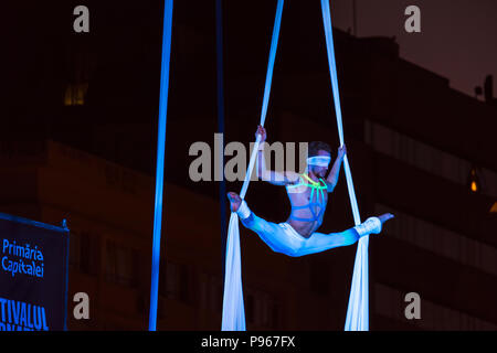 Bucharest, ROMANIA - July 14 2018: Blindfolded dancer from the Sonics in Wish performance at Street Theater Festival in Bucharest. Aerial acrobatics p - Stock Photo