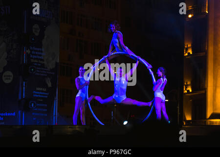 Bucharest, ROMANIA - July 14 2018: Sonics in Wish performance at Street Theater Festival. Graceful dancers on hula hoop circle - Stock Photo