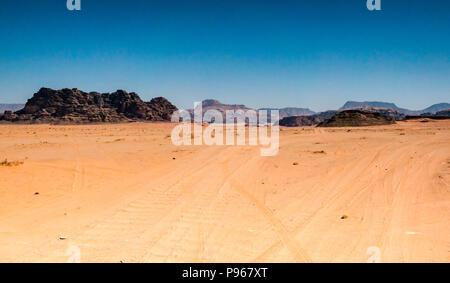 4x4 vehicle tracks in Wadi Rum desert valley, Jordan, Middle East - Stock Photo