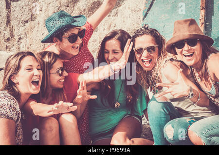 group of crazy nice beautiful caucasian girls outdoor under the summer sun doing a party all together. people having fun iall together oncept lifestyl - Stock Photo