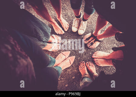 group of woman from high point of view with seven pair of feet with shoes and barefoot without. caucasian ladies in summer time. vintage colors and vi - Stock Photo