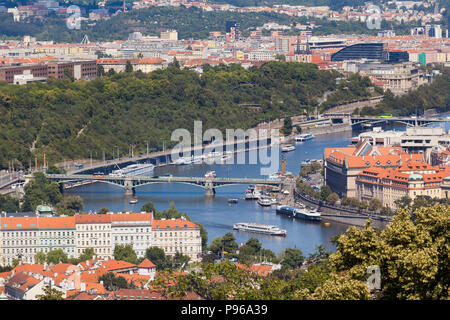 Panoramic view of Prague from near the Strahov monastery, showing the Cechuv and Stefanikuv bridges, bright sun, blue sky. - Stock Photo