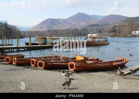 Motor launch Lady Derwentwater at landing stage at Keswick with passengers - Stock Photo