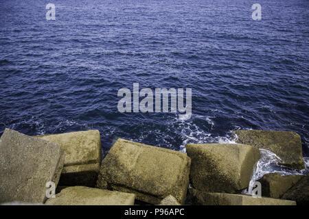 Rocks on a breakwater, sea shore detail - Stock Photo