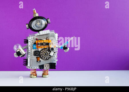 Robot electrician with light bulb screwdriver on violet wall gray floor background. copy space - Stock Photo