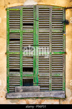 Abstract Rustic Background Of Old Broken Window Shutters On A Spanish Villa - Stock Photo