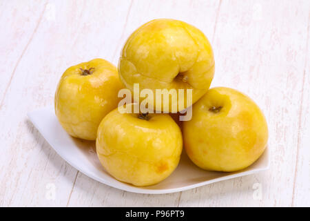Pickled yellow apple in the bowl - Stock Photo