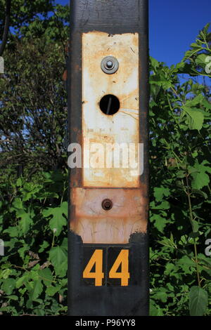 Number 44 on a steel lamppost at O'Hare airport in Chicago, Illinois. - Stock Photo